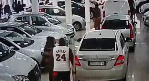 An angry customer smashed in a car window at a dealership.
