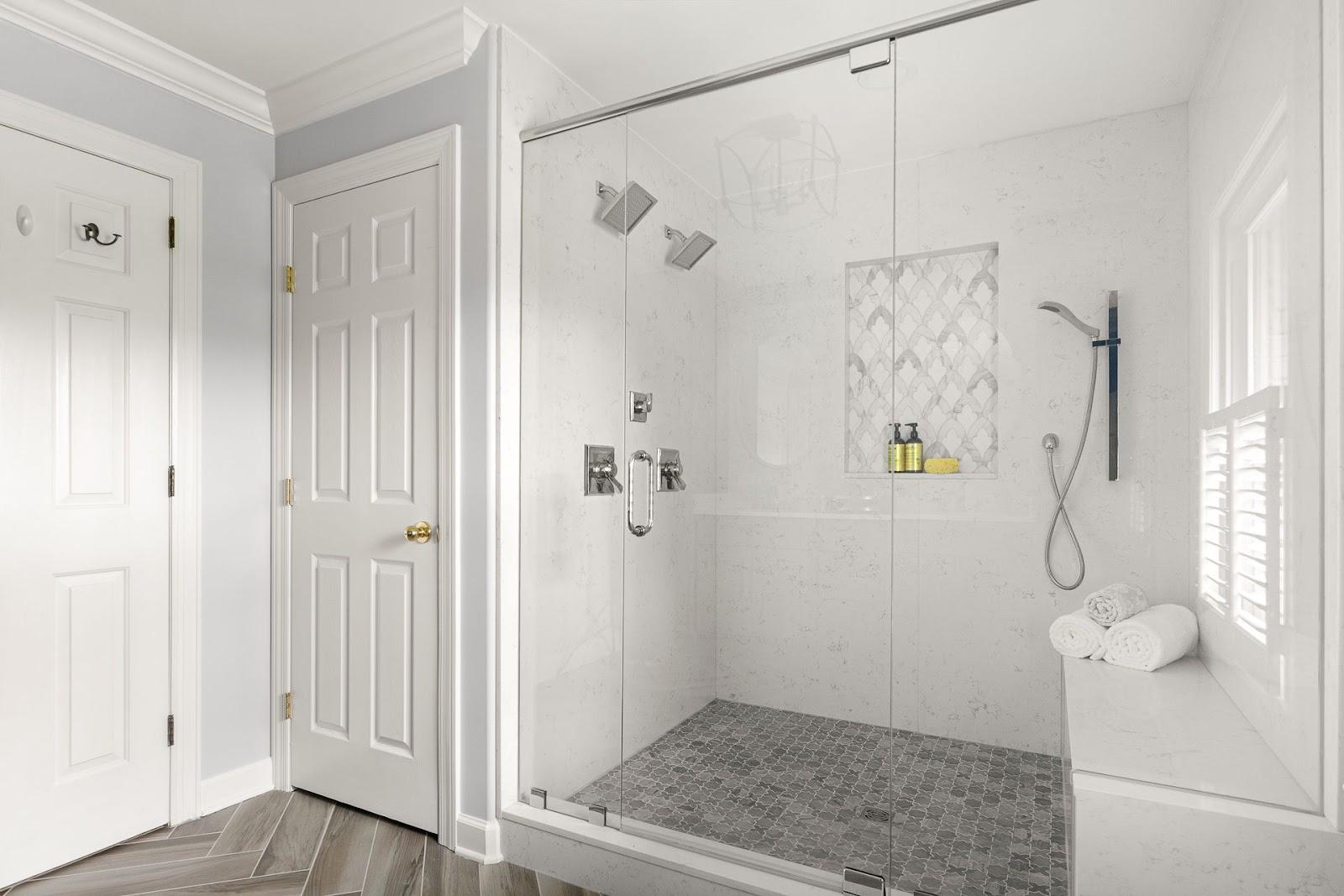 superior-construction-mt-juliet-tn-porcelain-vs-ceramic-bathroom-with-glass-shower-door-and-bench-tiled