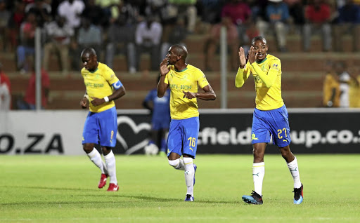 Thapelo Morena, right, celebrates with Sundowns teammates Anele Ngcongca and Hlompho Kekana on Tuesday.