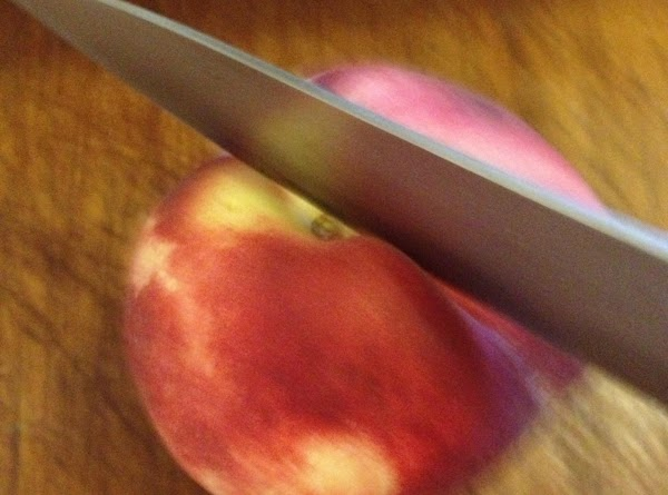 Using a sharp paring knife, cut a X on top of peaches. Place them...
