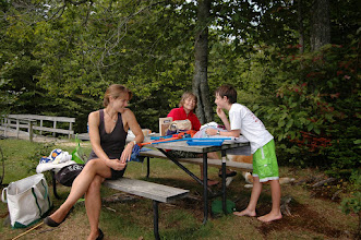 Photo: Family relaxing and having a discussion at Woodford State Park