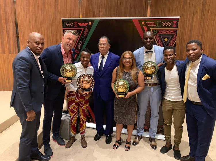Confederation of African Football (Caf) Women's Player of the Year Thembi Kgatlana poses with her award along with her coach Desiree Ellis and Mamelodi Sundowns goalkeeper Denis Onyango and other SA dignitaries in Dakar in Senegal on Tuesday January 8 2018.