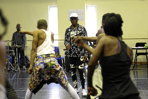 Somizi Mhlongo choreographing Gibson Kente's classic musical 'How Long?', which is being directed by Duma Ndlovu at The Playhouse in Durban.