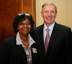 Photo: Evelynne Swagerty (Bank of America) and BBA President Paul Dacier.