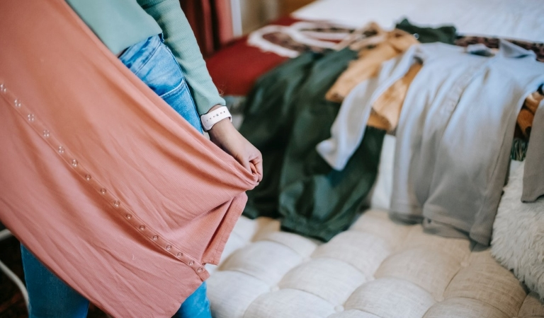 woman creating a capsule wardrobe while downsizing