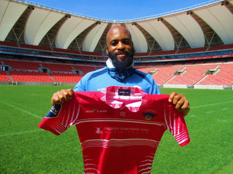 Oupa Manyisa poses with the Chippa United jersey at the Nelson Mandela Bay Stadium in Port Elizabeth after signing for the Eastern Cape-based club on March 30 2021.