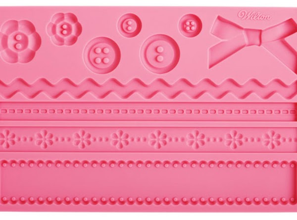 Simply press out colored buttons/bows/ribbons using Wilton® fondant molds. Use water and a clean...