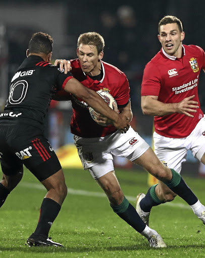 Fullback flurry: Liam Williams of the Lions is tackled by the Crusaders' Richie Mounga. Williams is pushing for a place in the Test team to face the All Blacks. Picture: DAVID ROGERS/GETTY IMAGES