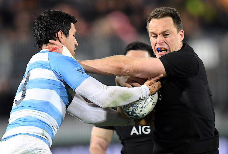 New Zealand's Ben Smith is tackled by Argentina's Matias Moroni during the Rugby Championship match at Trafalgar Park in Nelson, New Zealand on September 8, 2018.