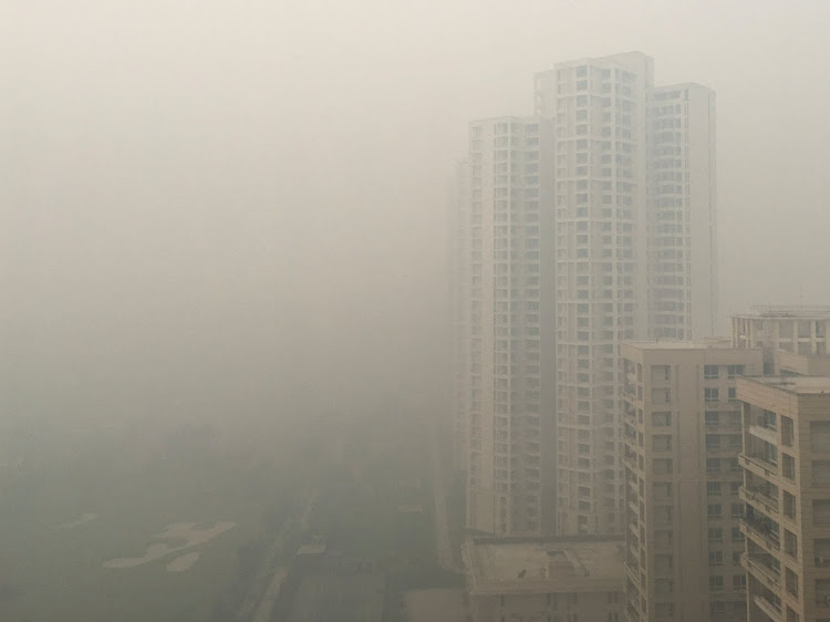 Residential buildings shrouded in smog in Noida on the outskirts of New Delhi, India, on November 5 2018. Picture: REUTERS/MALINI MENON