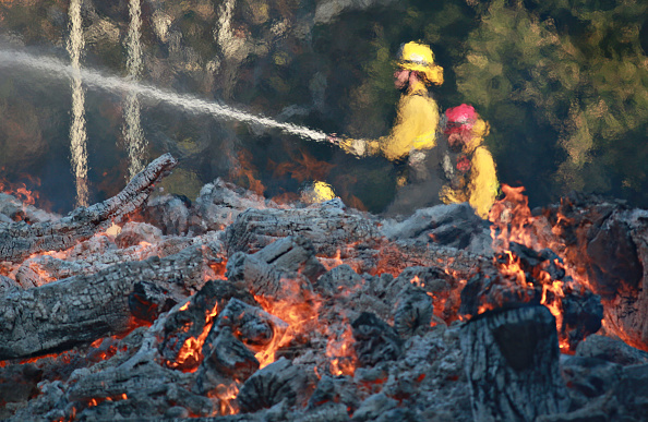 Firefighters battle a blaze at the Salvation Army Camp on November 10 2018 in Malibu, California. Picture: GETTY IMAGES/ SANDY HUFFAKER