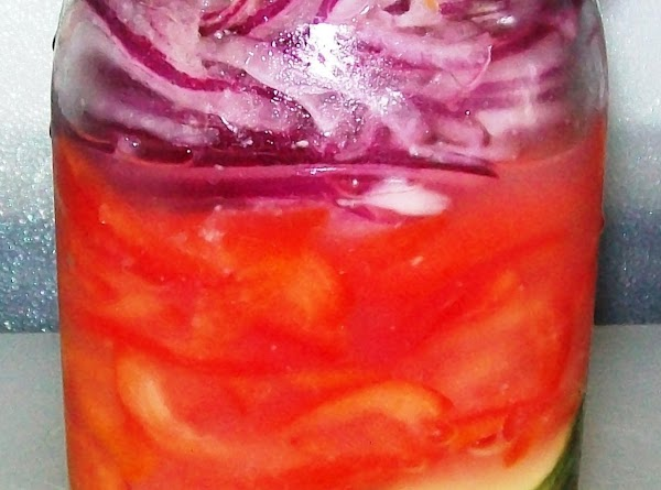 Layer the vegetables into the Mason jar; pour the lime mixture over the top.