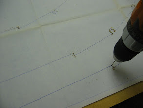 Photo: Drilling a small hole at each point.