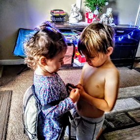 Gotta Go Bro by Carlo McCoy - Instagram & Mobile Android ( love, mixed kids, snowman, friendship, decorations, condo, instagram, christmas, latino, white, public holiday, model kids, indoor, snowflakes, family, brother, sister, lights, kids,  )