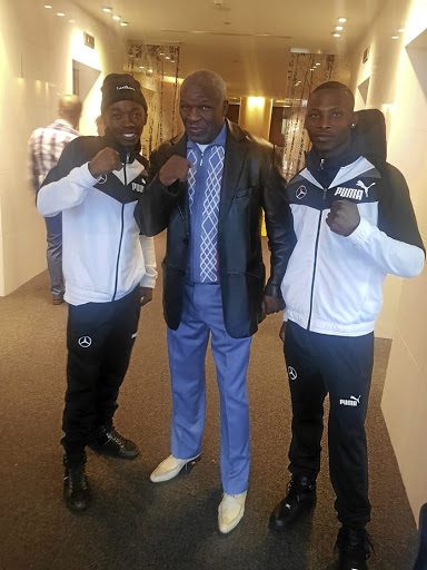 WBO bantamweight champion Zolani Tete, right, and trainer Mhikiza Myekeni, left, with American trainer Floyd Mayweather snr in Russia, where Tete will defend his title on Sunday.