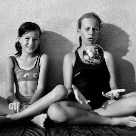 A ball by Tomasz Budziak - Babies & Children Child Portraits ( girls, black and white, greece, holidays, portrait,  )