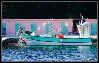 Photo: The wonderful color harmony of the coastal fisherman.