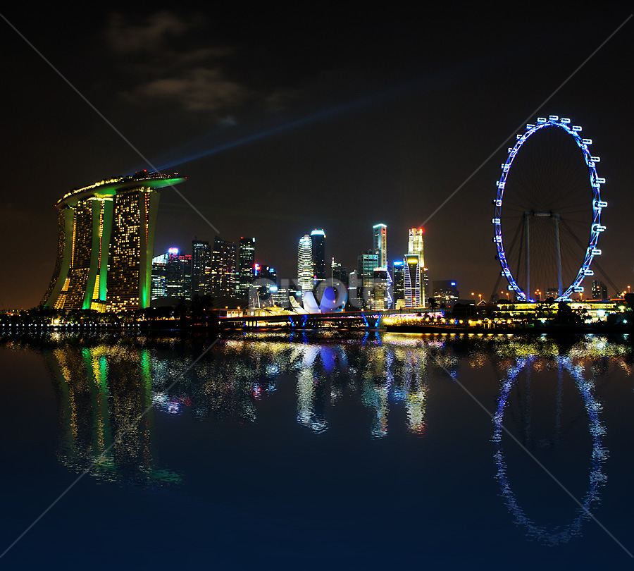Reflections at Marina Bay by Jenny Zhang - Buildings & Architecture Office Buildings & Hotels ( illuminated, skyline, metropolis, exterior, architecture, travel, cityscape, city, center, sky, marina, central, light, commercial, financial, structure, twilight, tourism, dusk, landmark, bay, outdoors, town, bridge, waterfront, famous, reflection, landscape, business, singapore, modern, riverside, skyscraper, southeast, asia, district, evening, tall, downtown, office, water, sand, building, sea, urban, tower, blue, finance, night, river )