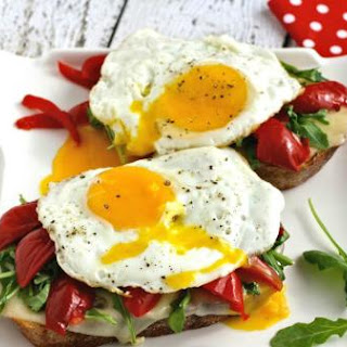Grilled Cheese Sandwiches With Roasted Red Peppers, Arugula And Fried Egg.