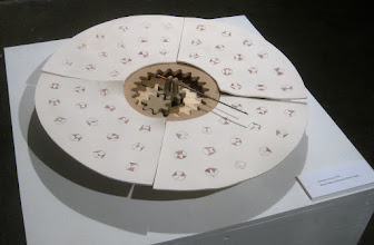 """Photo: """"Symmetry Group"""" Another presentation of the sixty eight-bar, single degree-of-freedom kinematic chains. It is placed on a lazy susan turntable and ceramic gears reverse the rotation of the inner feature."""