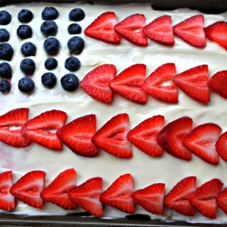 A 4th of July Vanilla Poke Cake with Kool-Aid Fruit Juice.