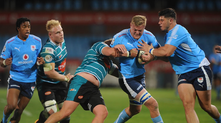 Jano Venter of Blue Bulls is tackled by AJ le Roux of Griquas during the Currie Cup Rugby match on September 1 2017 at Loftus Versfeld Stadium.