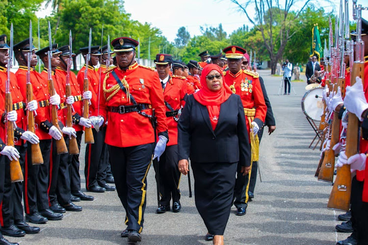 President Samia Suluhu inspects a guard of honour.