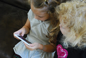 Photo: Both girls loved playing with the Royal Ball App.