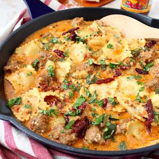 One Pot Pasta Sausage Pesto & Cheese Ravioli.