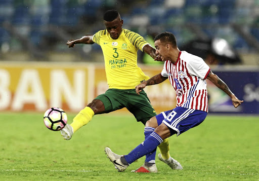 Innocent Maela of SA, left, and Alejandro Gamarra of Paraguay in the 2018 Nelson Mandela Challenge match at Moses Mabhida.