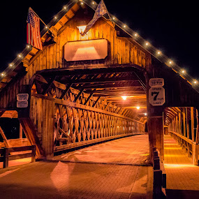 Frankenmuth Covered Bridge at Night by Chris Mowers - Buildings & Architecture Bridges & Suspended Structures ( flag, covered bridge, night, bridge, frankenmuth )