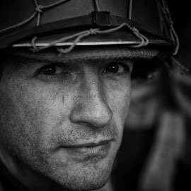 GI by Marco Bertamé - Black & White Portraits & People ( gi, ww2, soldier, helmet, american, looking, man, portrait, male, us )
