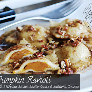 Pumpkin Ravioli with Hazelnut Brown Butter Sauce and Balsamic Drizzle.