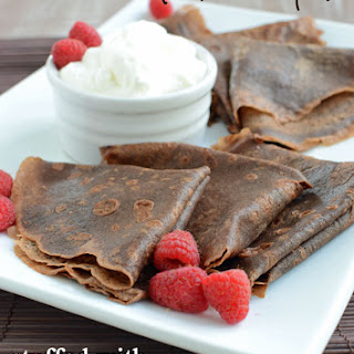 Dark Chocolate Crepes stuffed with Chocolate Raspberry Ganache and Kahlua Whipped.