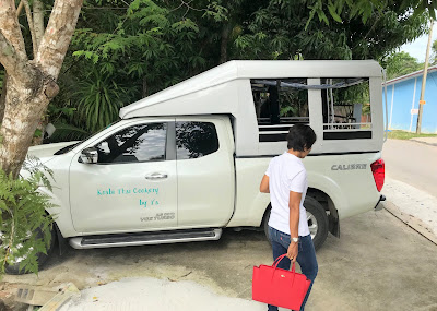Pickup service by local truck (songthaew)