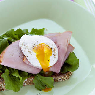 Poached Egg Toasts with Arugula and Ham.