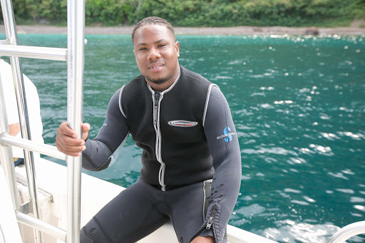 Odell, a diving instructor who accompanied snorkelers during an excursion in Dominica on the sport fishing boat Sharpshooter.