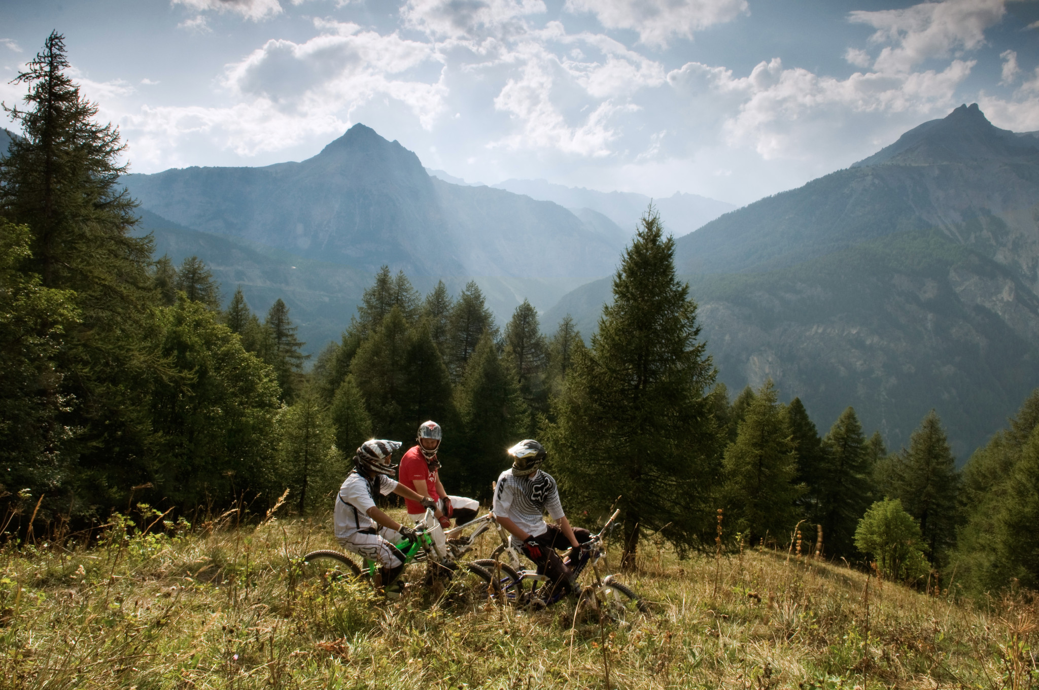 Photo: In August 2011, the WorldBikeParks.com Ultimate Road Trip team rolled into Bardonecchia, Italy, for 3 fantastic days of bike park riding.  Local riders Alex and Riki showed us the way around, and we even bumped into the Athertons, Gee and Rachel, on the final morning. Here, Alex, Riki and WorldBikeParks.com rider David Scorer discuss the trail amidst stunning scenery.