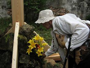 Photo: Цветы к подножию креста