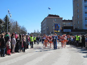 Photo: Cheerleaders and marching band