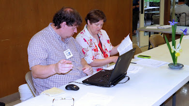 Photo: Jaime Hadley and Dara Smith prepare to enter all show data into the computer.