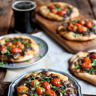 Porter Caramelized Onion Flatbreads with Smoked Gouda and Roasted Tomatoes.