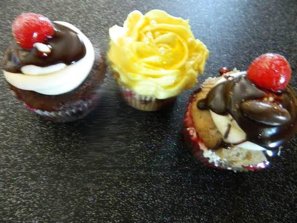 This Photo Shows My Three Favorite Cupcakes (so Far!): Hot Fudge Sundae, Sundrop Lemon, And Banana Split. Two Of Them Have The Chocolate Ganache On Them.