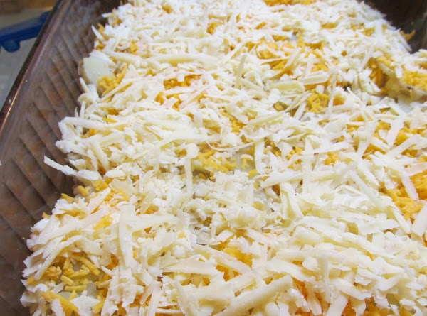 Next add  half of the shredded swiss cheese, parmesan & mozzarella.