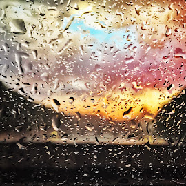 Raindrops on a window glass  by Valerio Rosati - Landscapes Weather ( drop, waterdrops, color, beauty, droplet, waterdrop, yellow, pattern, clouds, pouring, red, psychedelic, drops, multi-colored, fall, textured, condensation, nobody, close, rain, macro, vibrant, green, storm, reflection, nature, droplets, wet, clear, rainwater, abstract, moisture, water, raindrop, orange, multicolored, close-up, liquid, closeup, raindrops, light, background, purple, shiny, colourful, autumn, colorful )