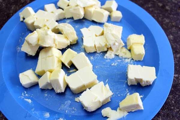 Diced margarine on a blue plate.
