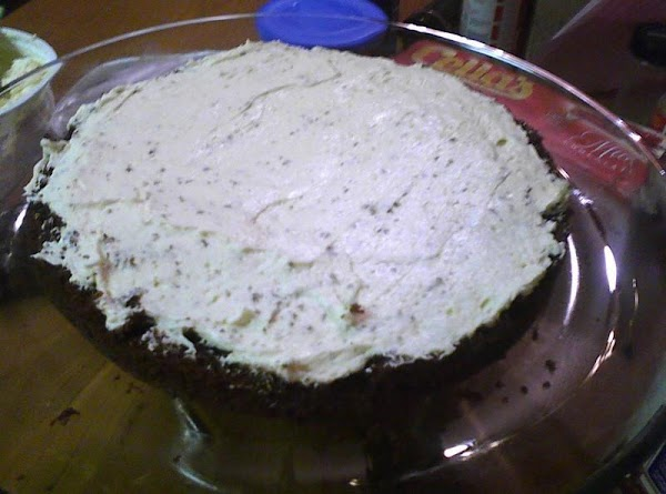 Once your cakes are cooled start building them. Use the cheesecake filling and spread...