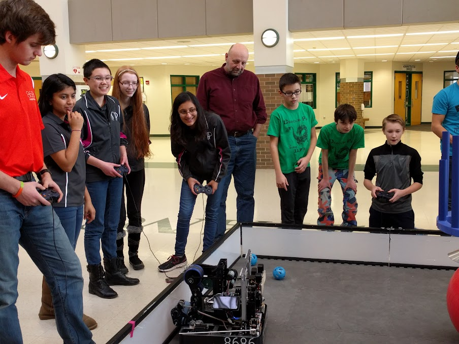 Driving the robot as a teacher watches