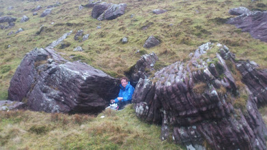 Photo: Helen taking a break for lunch between the rocks on Pat Donovan's B walk to Lake Diheen, Sunday February 23rd, 2014