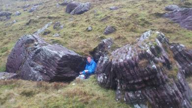 Photo: Helen taking a break for lunch between the rocks on Pat Donovan's B walk to Lake Diheen, Sunday February 23rd, 2014
